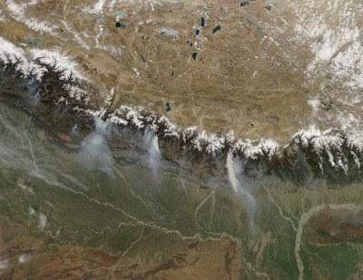 On March 12, 2009, the Moderate Resolution Imaging Spectroradiometer (MODIS) on NASA's Aqua satellite caught a glimpse of a relatively rare event: large–scale forest fires in the Himalaya Mountains of Nepal. The numerous small fires in southern Nepal may not be wildfires, but rather agricultural or other land-management fires. ... conditions during the fall and winter of 2008 and 2009 were unusually dry, and fires set by poachers to flush game may have gotten out of control.
