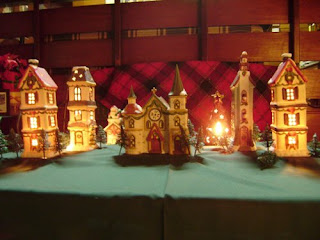 daughter 4 helped in making the house clean and presentable for tomorrows party she even lighted our very poor christmas village for size