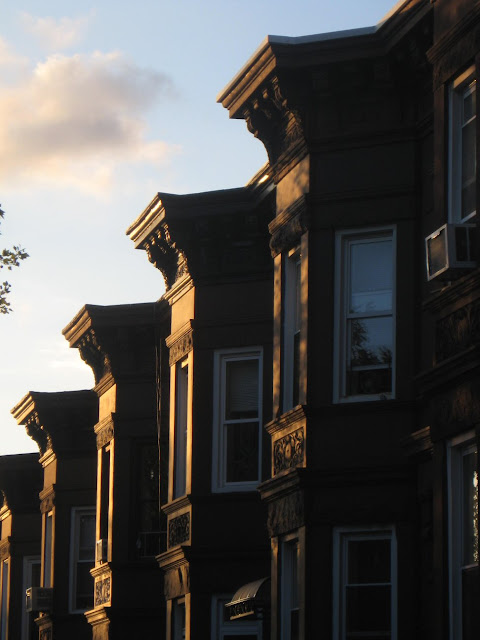 A row of brownstones at sunset