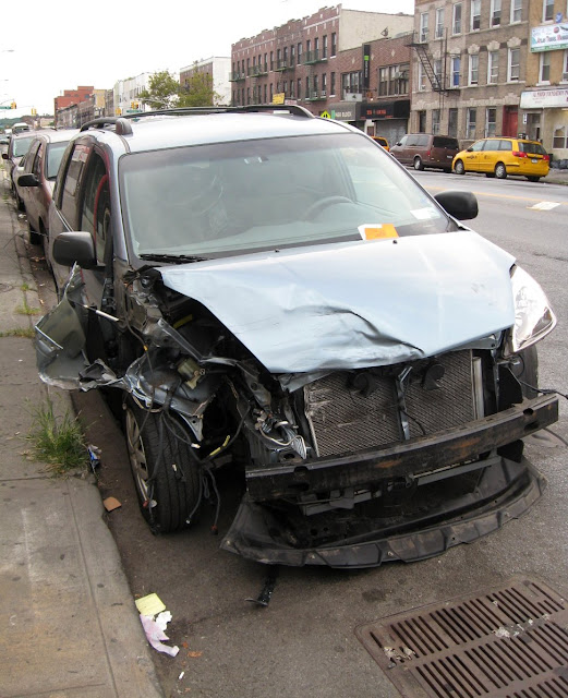 Wrecked car with parking ticket