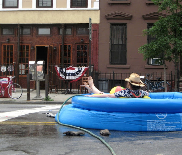 Woman on street in inflatable pool