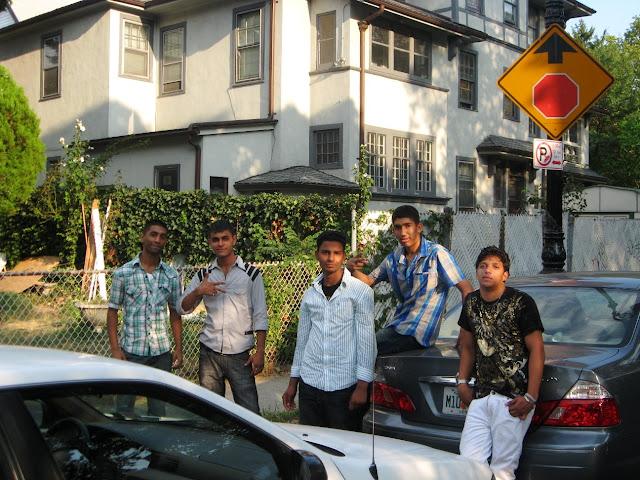Pakistani teenage guys posing on street