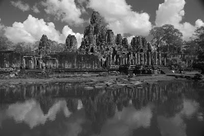 Bayon temple at Angkor Wat over the lake B&W shot