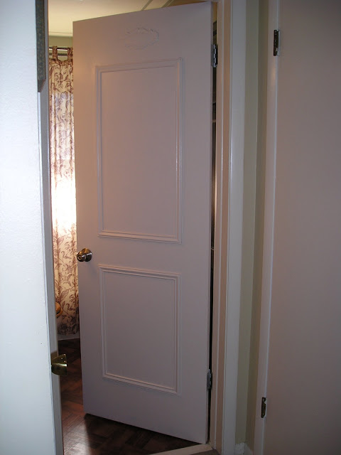 How to faux panel a door update your flat paneled door for Cost to paint interior doors and trim