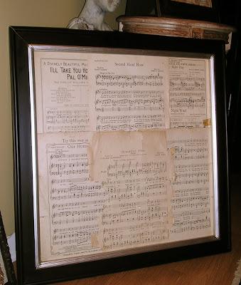 Vintage sheet music on a bulletin board
