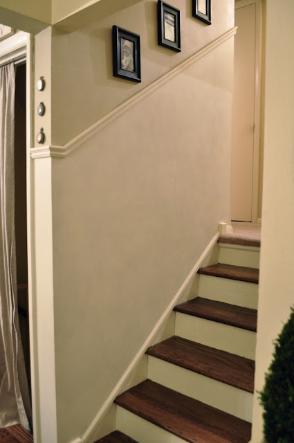 Stariway makeover with painted risers and stained treads