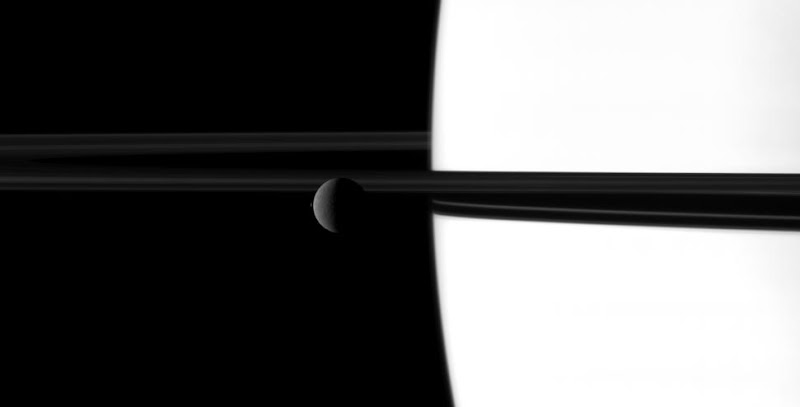 Rhea, Saturn and its rings.