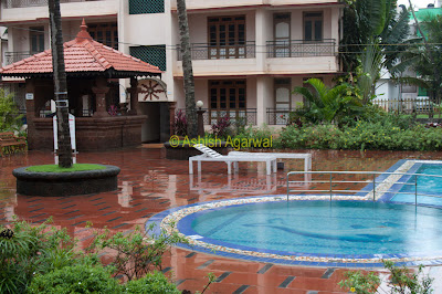 View of kids pool, bar, and surrounding apartments at the Palmarinha Resorts in Goa