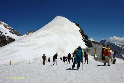Tourists enjoying on the glacier next to Jungfrau