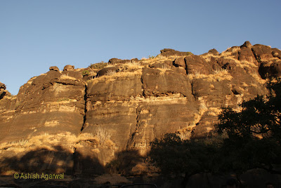 Rocky hillock at Dhoopgarh getting highlighted by sunset