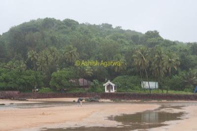 The water of the Baga creek merging with the sea at Baga beach in Goa