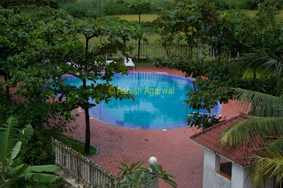 View of the smaller pool of the Palmarinha Resort in Goa, at the back side of the resort