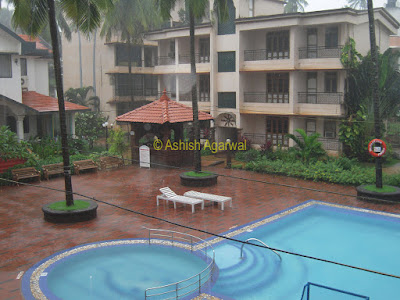 The Palmarinha Resort in Goa, as seen on a rainy day, with a swimming pool in the middle