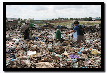 CHILDREN DIGGING and THOUSANDS LIVING IN LANDFILLS FOR BREAD