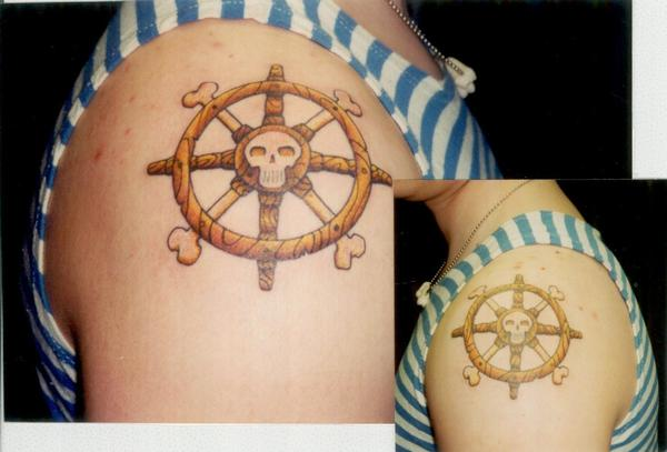 Belgian Teenage Girl With 53 Too Many Tattooed Stars Tattoo; Color, Boat Wheels with Skull, Both Arms. Posted by Collin Kasyan