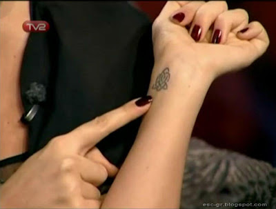Hadise showing her tatoos