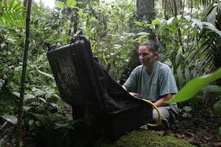 Costa Rican Juanita Zeledon uses a special camera and laptop to take photos of the root systems of plants at La Selva Biological Station on the edge of Braullio Carrillo National Park north-east of San Jose, Costa Rica, Monday May 7, 2007. The U.S. and Costa Rican governments announced negotiations for $ 12.6 milion dollars of debt to be forgiven in return for Costa Rica's conservation of the environment under the Tropical Forest Conservation Act.(AP Photo/Kent Gilbert)