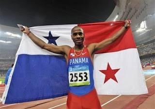 Panama's Irving Saladino celebrates after winning the gold in the men's long jump final during the athletics competitions in the National Stadium at the Beijing 2008 Olympics in Beijing, Monday, Aug. 18, 2008. (AP Photo/Thomas Kienzle)