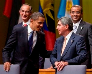 President Barack Obama, front left, greets Costa Rica's President Oscar Arias during the opening ceremony of the Summit of the Americas on Friday, April 17, 2009 in Port-of-Spain, Trinidad and Tobago. (AP Photo/Evan Vucci)