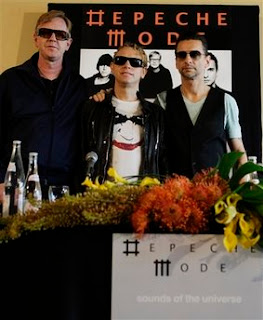 Depeche Mode members Martin Gore, center, Dave Gahan, right, and Andrew Fletcher pose for a photo in Tel Aviv, Israel, Friday, May 8, 2009. Depeche Mode will start their tour on Sunday in a concert in Tel Aviv. (AP Photo/Ariel Schalit)