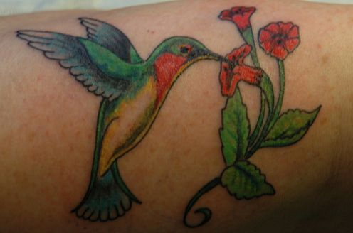 the hummingbird tattoo add to balance, like most shuttle tattoos.
