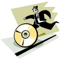 Image of man chasing after software disc from MS ClipArt