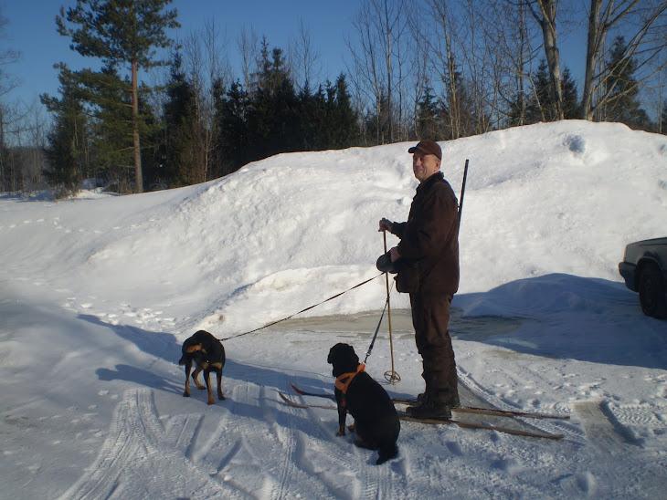 Far med sina hundar