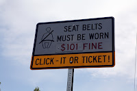 SEAT BELTS MUST BE WORN - $101 FINE - CLICK-IT OR TICKET!