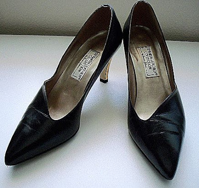 Black Leather Shoes with Gold Colored Star Imprinted Heels