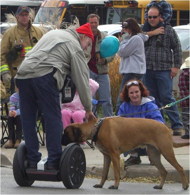 The guy on the Segway, not the dog.