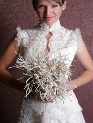 wedding bouquet: feather bouquets are a chic alternative to traditional wedding bouquets