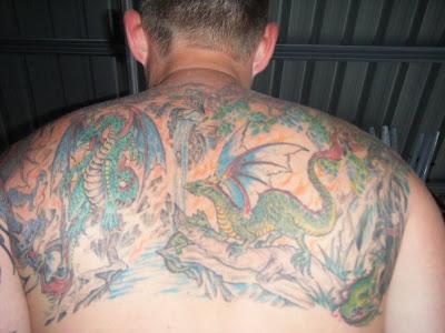 Dinosaurs vs Dragon Tattoo Designs