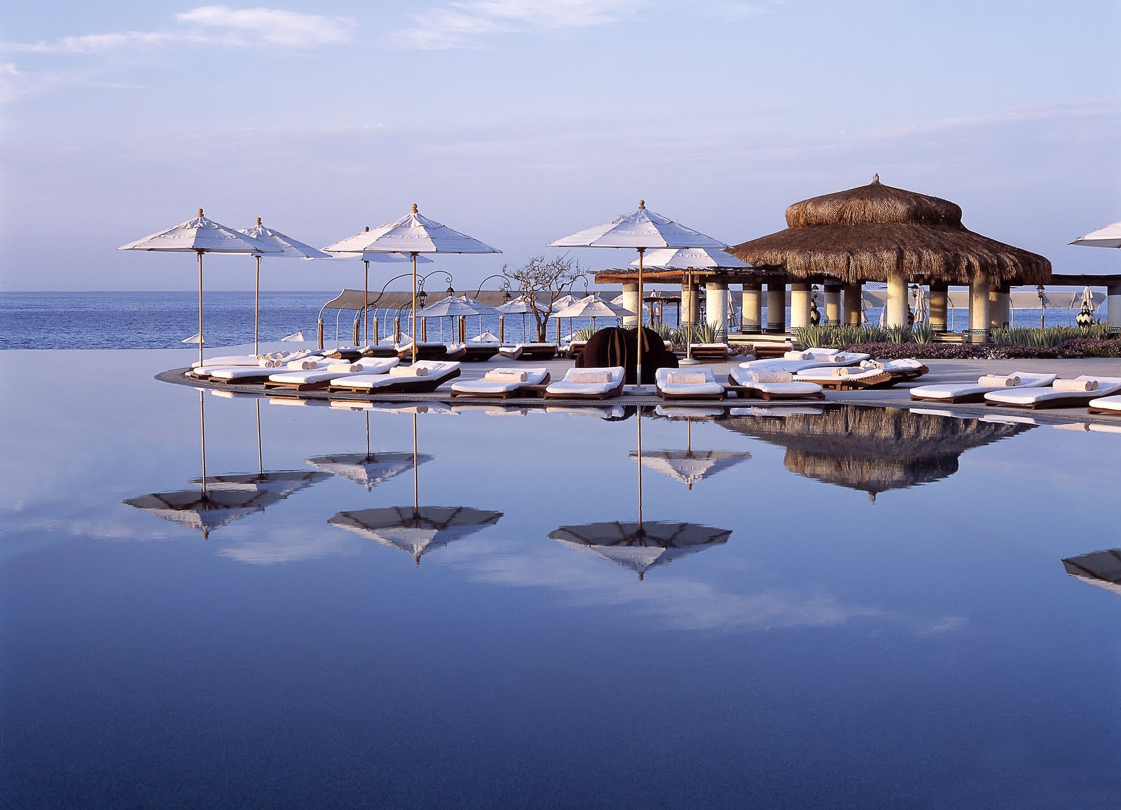 Las Ventanas Resort  Eye Awards: The World's best luxury hotels InfinityPoolUmbrellas
