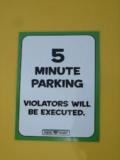 Simpsons Movie 7-Eleven Kwik E Mart takeover - parking violation sign