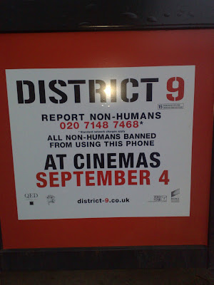 District 9 phone box hotline advertising
