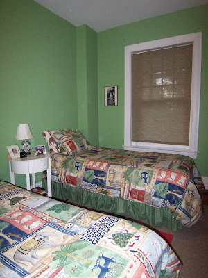 green bedroom twin beds