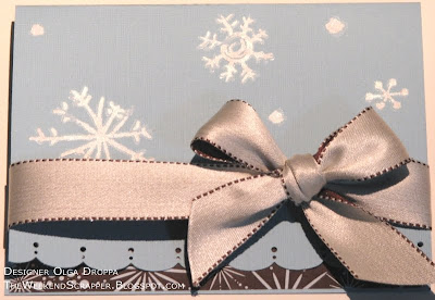 Handmade winter or Christmas card with snowflake rub-ons and a large bow