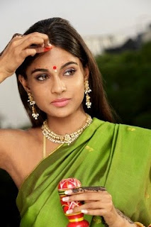 Indian woman applying Sindhoor