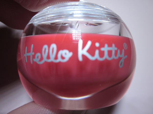 The Hello Kitty logo and font is present on both sides of the packaging with