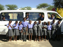 Grade 1 children at the schoolbus.