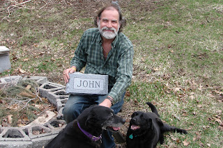 click here to see the Full Size of this image of Kevin + his dogs around the fire circle where we had Johnny's memorial service in Feb 2008