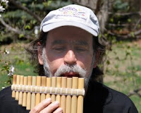 click here for Full Size image of Kevin playing his pan flute