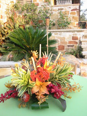 Mmm lots of wiltproof centerpieces for an outside summer soiree