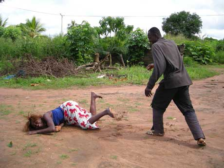 man beating woman