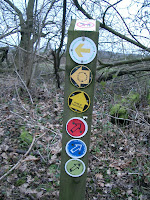 Waymark post with multiple direction signs