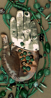 detail, beaded necklace with fabricated metal hand by Robin Atkins, bead artist