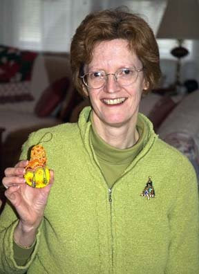 Mary Tod holding pear ornament
