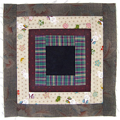 God's Eye Quilt by Robin Atkins, auditioning fabrics 23