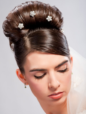 Two versions A sleek Audrey Hepburn bun with stick pin jewels