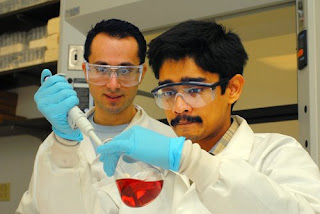 post-doctoral fellow Sudip Nath and graduate student Charalambos Kaittanis